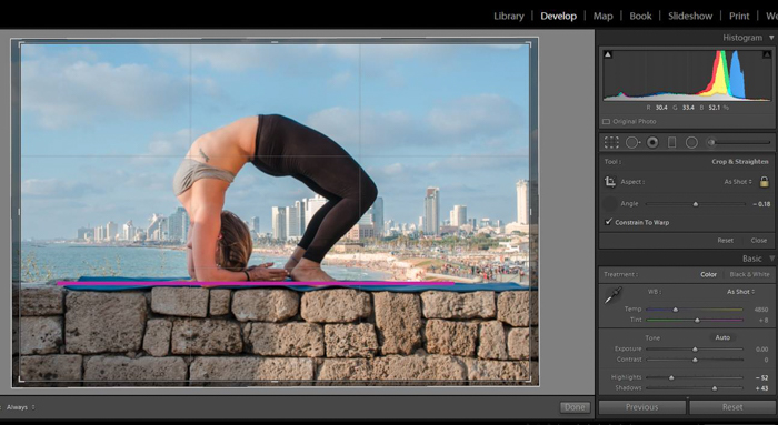 changing aspect ration of a photo of a woman in a yoga pose on a stone brick wall in lightroom