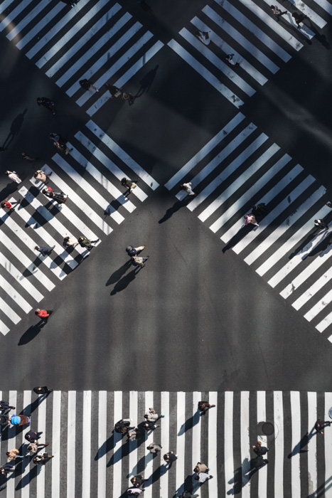 An aerial view of a busy pedestrian street crossing