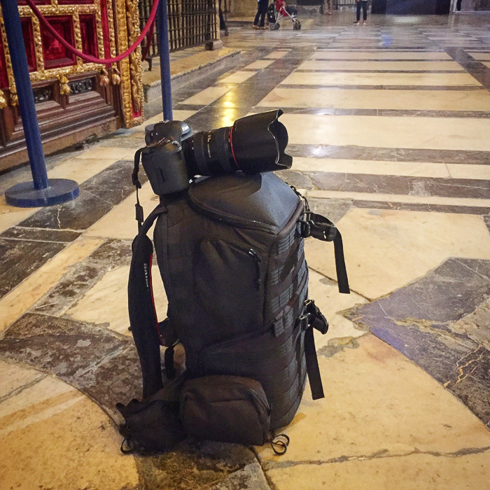 DSLR camera on a bag used as a tripod in a museum