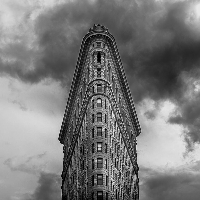 Black and white architecture photography shot of the facade of the Flatiron building in New York
