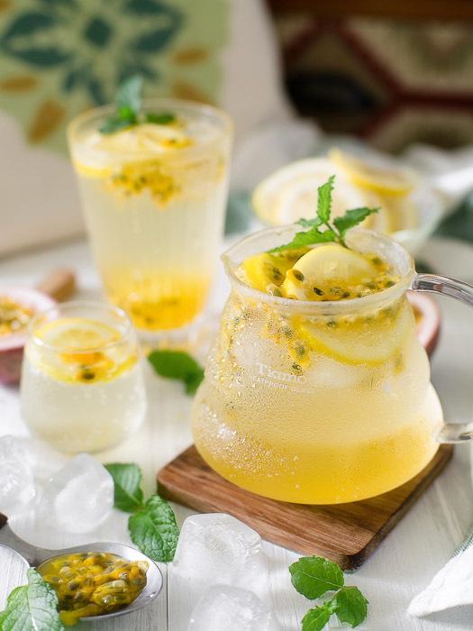 Bright and airy food photo of a jug of fresh lemonade and glasses