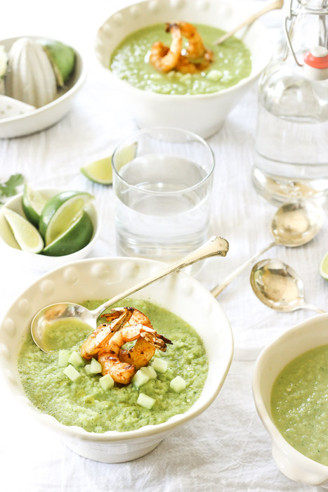 A bright and fresh feeling photo shoot of a lunch setup including green soup with pawns