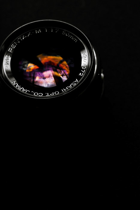 A close up of a camera lens on dark background - how to clean a camera lens