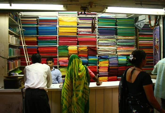 A candid shot of customers in a textile shop