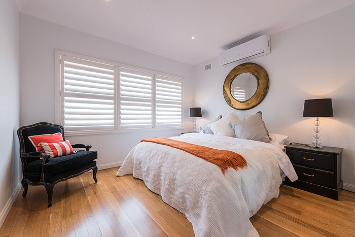 Pretty real estate photography shot of the interior of a bedroom