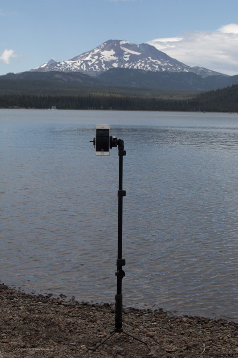 Using a tripod for an iphone photo pointed towards a lake and mountain