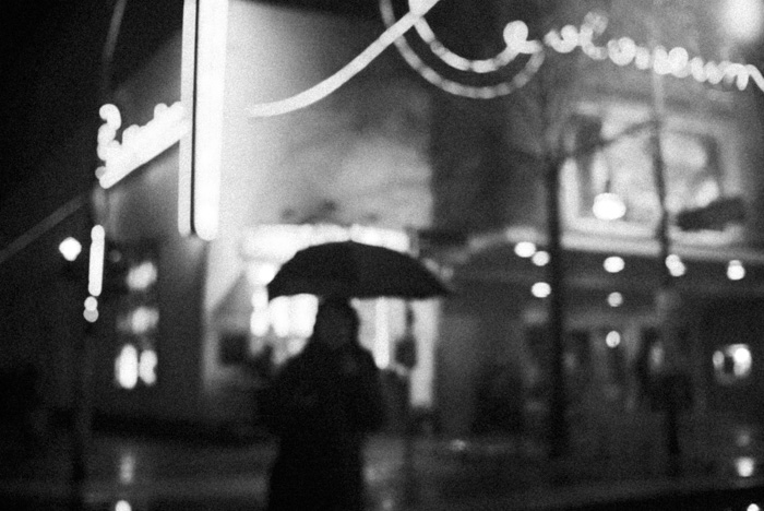 A grainy black and white street photography shot taken with ISO 3200+