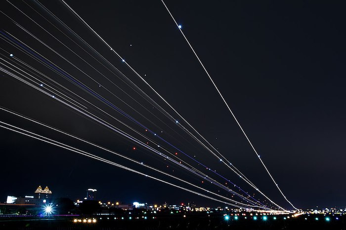 Light trails from landing/taking off planes.