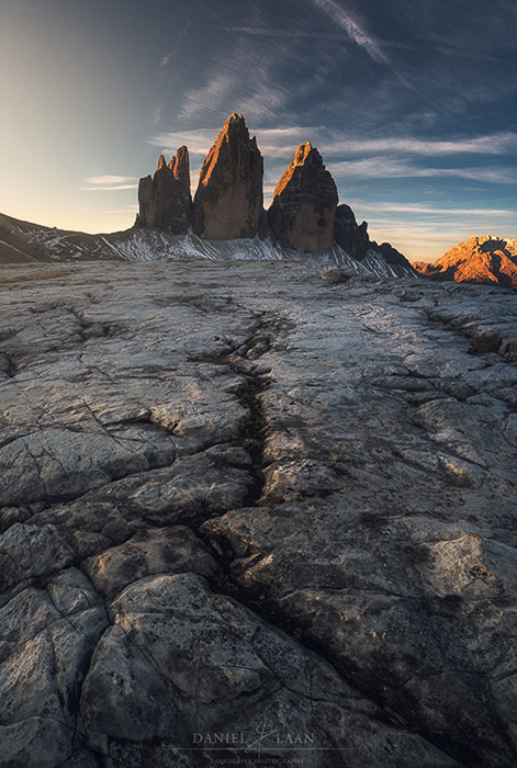 Fantastic view of rocky mounatins with cracked earth in the foreground