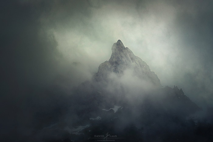 Atmospheric misty shot of a lone peak in the Swiss alps