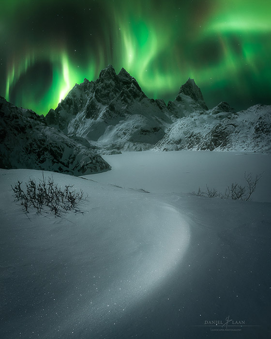The northern lights dancing above a remote area in the Lofoten.