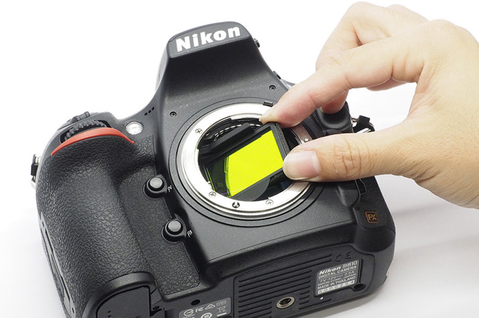 Overhead shot of fitting a nd filter to a nikon camera