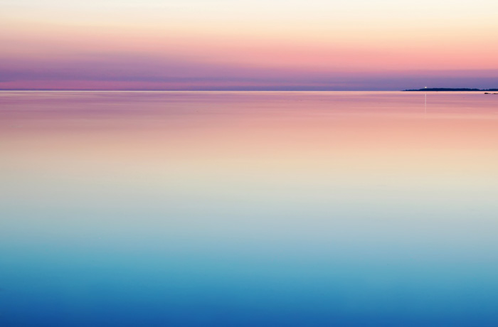 A stunning seascape shot at sunset with marvelous colours reflected from the sky to the water shot with a ND filter