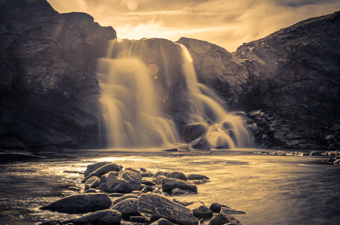 A monochrome shot of a waterfall with soft misty water effect achieved using long exposure and an nd filter