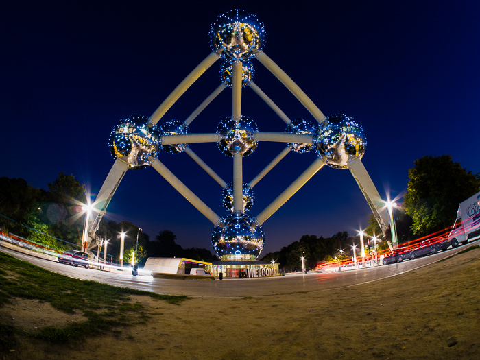 The Atomium at night with traffic passing under photographed with fish eye lens