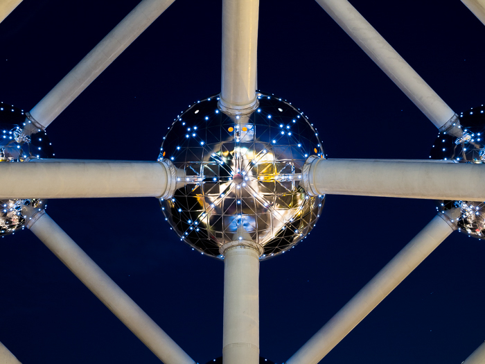 Close up detail of a part of the The Atomium, city lights reflecting in the sphere