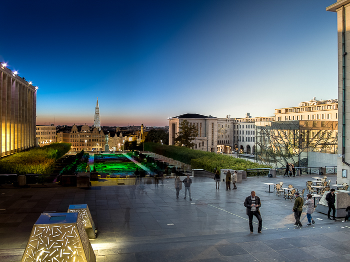 Mons des Arts in Brussels, Belgium. night to day photo at dusk, the buildings with colourful lights