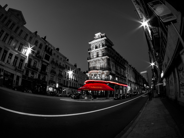 Black and white photo with selective colour red lights