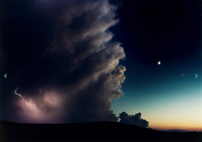 A dramatic landscape at night during a storm by wildlife photographer Joel Sartore