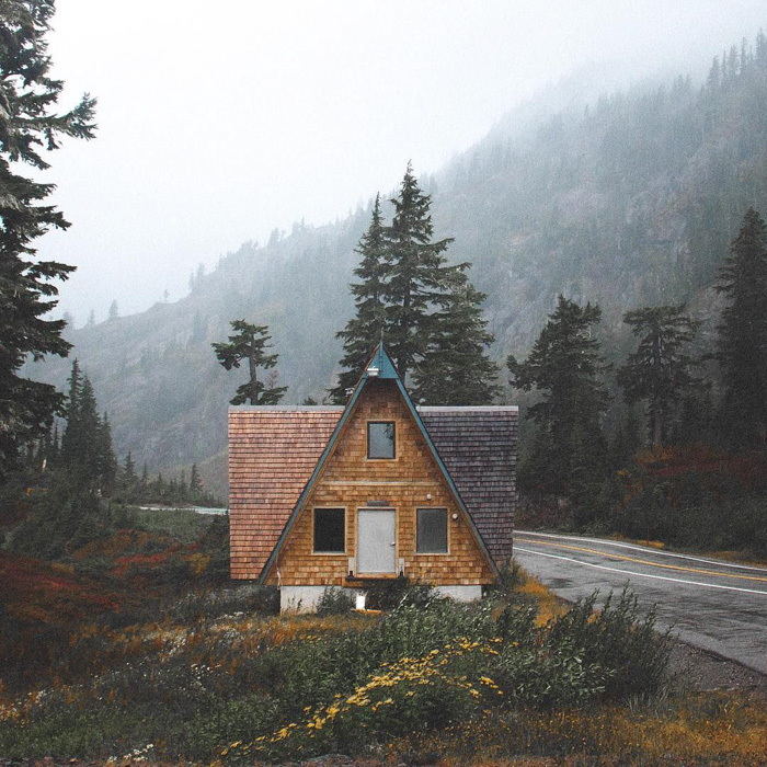 A house in a beautiful landscape on a foggy day by outdoor photographer Zach Melhus