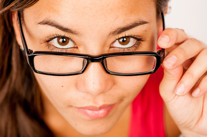 close up photography composition of a woman in a red shirt and glasses looking up