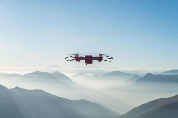 A photography done flying over a beautiful mountainous landscape