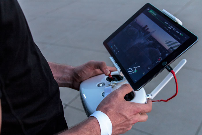 Close up of a man with remote control for drone photography