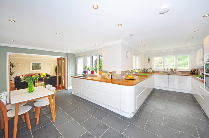 An interior image of a white kitchen