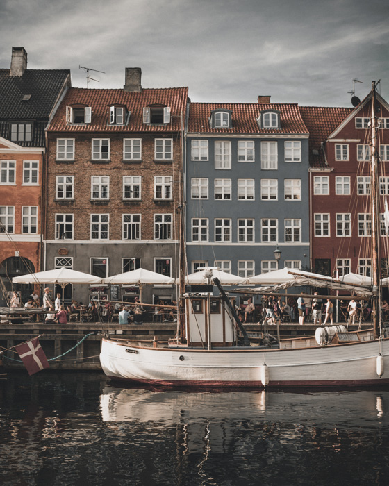 A stock photo of a boat parked at a city canal