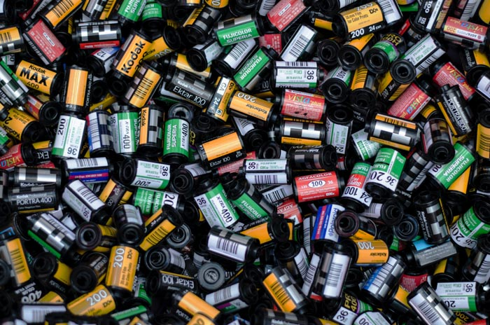 A huge pile of different types of photography film rolls for street potography