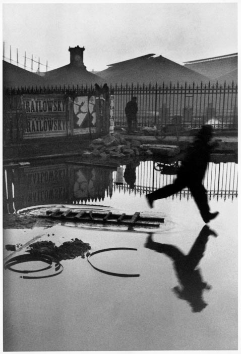 A Henri Cartier-Bresson photo of a man jumping into a puddle - composition techniques