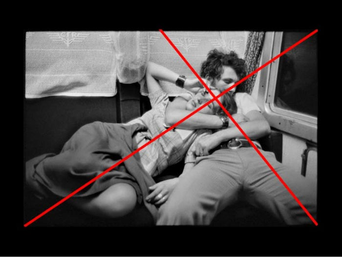 A Henri Cartier-Bresson photo of a two people on a train, with composition grid overlayed