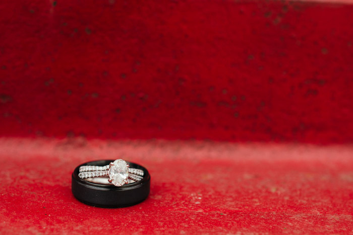 Close up photo of two wedding rings on red background