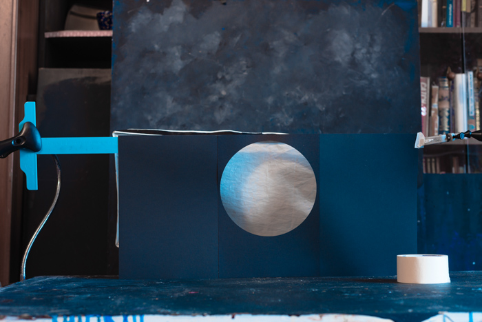 Set up of creating a moon for Halloween still life photo