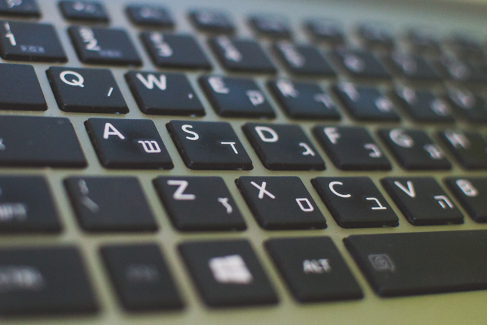 A close up of a laptop keyboard - best Photoshop shortcuts