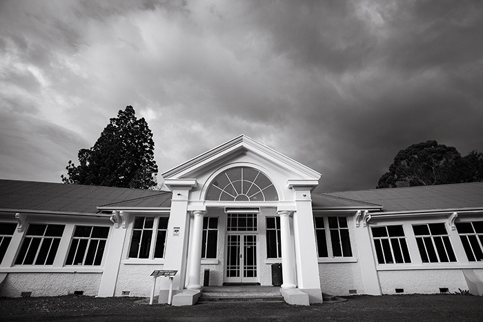 black and white photo of the archway entrance of The Chisholm Ward at Queen Mary Hospital in Hanmer, New Zealand - black and white photo editing