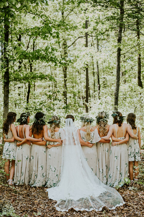 A wedding party posing in a forest area- camera focus for sharp group photography