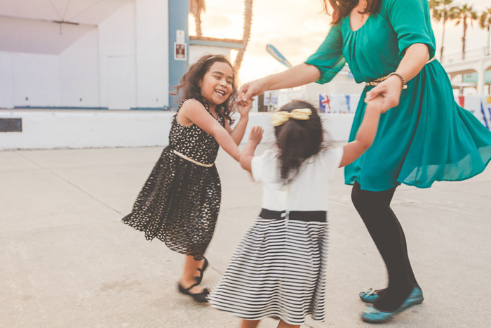 Two children dancing with their mother - kids photography