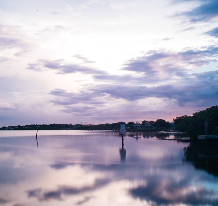 A cloud photo at evening time over a pretty coastal seascape