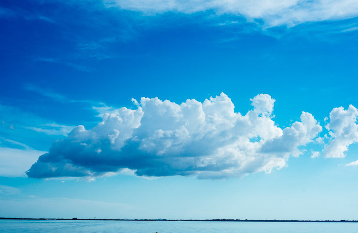 Beautiful clouds on clear blue skies over a seascape