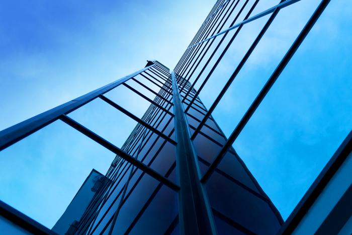 Interesting photo composition of a modern office building on a clear sky background