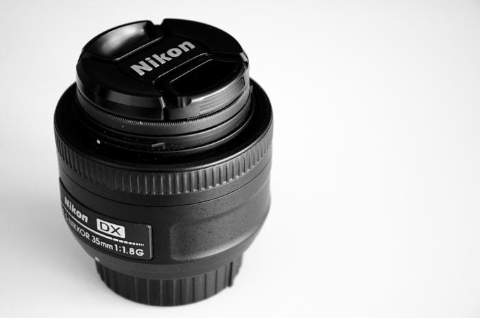 A nikon lens on a white background