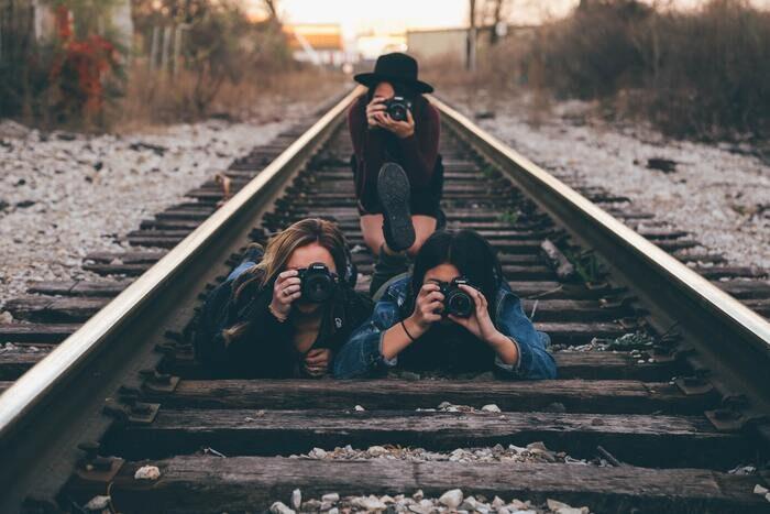 Photo of photographers on railroad tracks