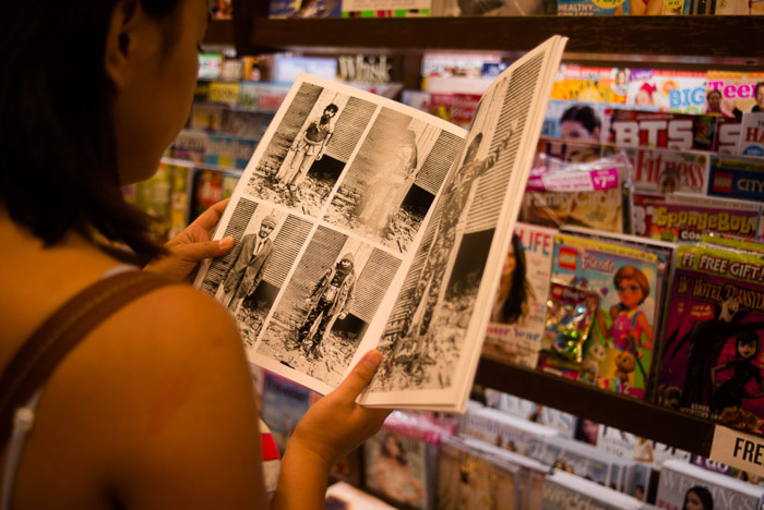 A girl reading a magazine in a shop - magazine photographer tips