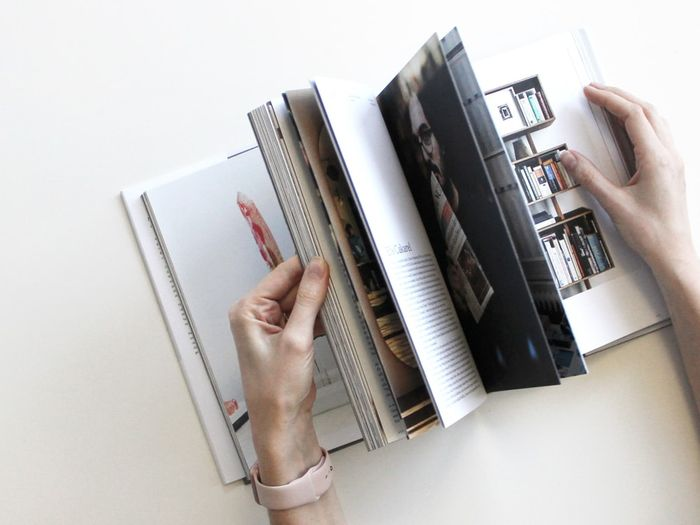 Photo of someone flipping through a photo book