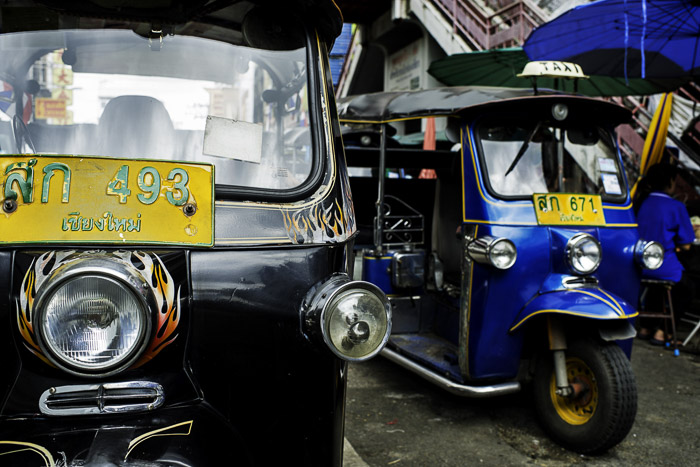 a close up of two tuk tuks - photo composition tips