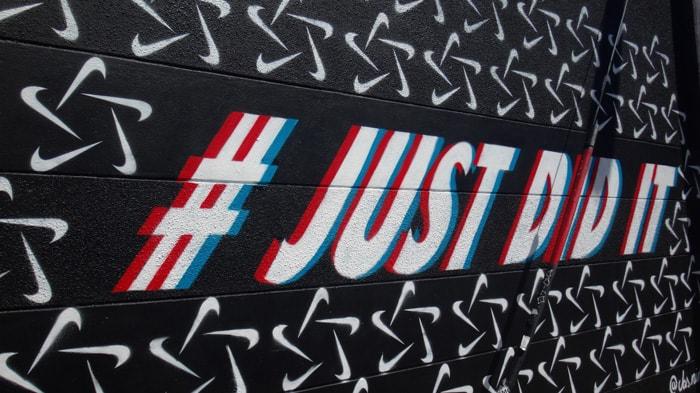Wall graffiti reading '#justdidit'