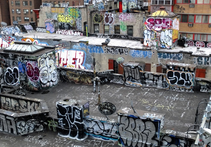 Aerial view of an abandoned industrial area covered with graffiti