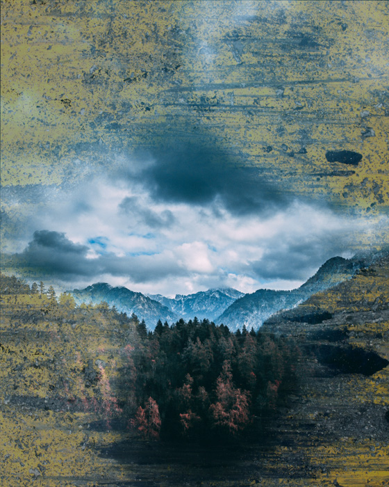 A dramatic landscape scene with scratchy ochre and grey photoshop texture added