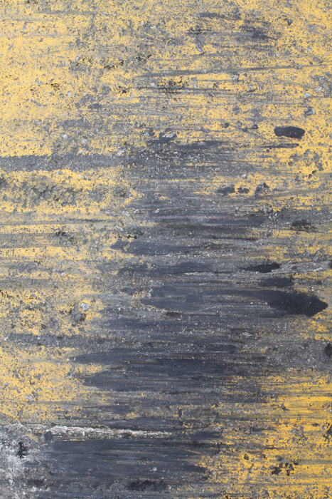 A scratchy ochre and grey textured photo
